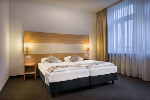 Novum Hotel Continental Frankfurt - Frankfurt - Makuuhuone
