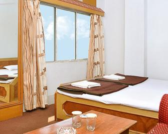 Hotel Yashoda International - Deoghar - Спальня