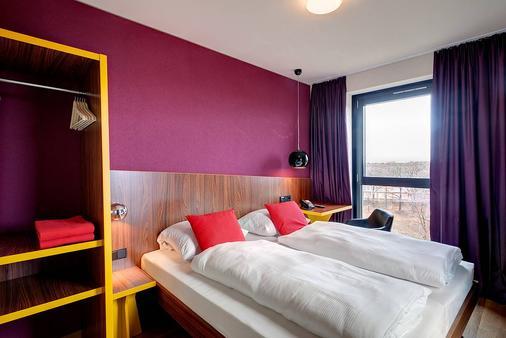 Meininger Hotel Frankfurt/Main Airport - Frankfurt am Main - Bedroom