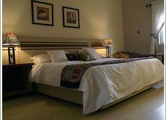 Axari Hotel - Calabar - Bedroom