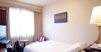 Hotel Claiton Shin-Osaka - Ōsaka - Schlafzimmer