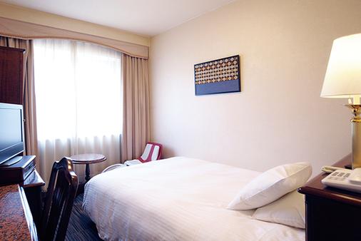 Hotel Claiton Shin-Osaka - Osaka - Quarto