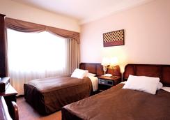 Hotel Claiton Shin-Osaka - Осака - Спальня