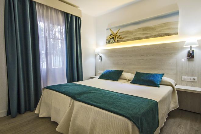 THB 花卉酒店 - 蒂亞斯 - 卡門港 - 臥室