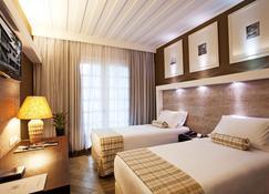 Casa Grande Hotel Resort And Spa - กัวรูจา - ห้องนอน