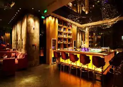 Howard Johnson by Wyndham Parkland Hotel Dalian - Dalian - Bar
