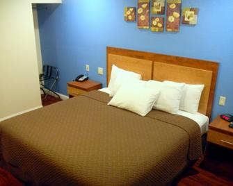 FairBridge Inn & Suites Merced/Gateway to Yosemite - Merced - Schlafzimmer