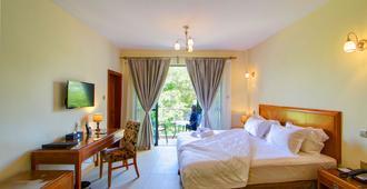 Lotos Inn & Suites, Nairobi - Nairobi - Schlafzimmer
