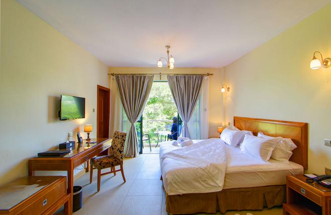 Lotos Inn & Suites, Nairobi - Nairobi - Bedroom