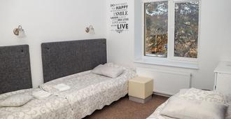 Happy Inn - Kauen - Schlafzimmer