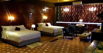 Golden Lotus - Bengaluru - Schlafzimmer