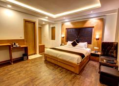 Hill County Resort & Spa, Manali - מאנאלי - חדר שינה