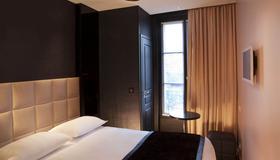 First Hotel Paris Tour Eiffel - Parigi - Camera da letto