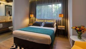 Prima City Hotel - Tel Aviv - Schlafzimmer