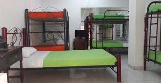 Hostal Deluxe Santander - Manizales - Phòng ngủ