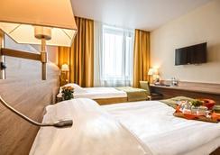 SKYEXPO Hotel - Nowosibirsk - Schlafzimmer