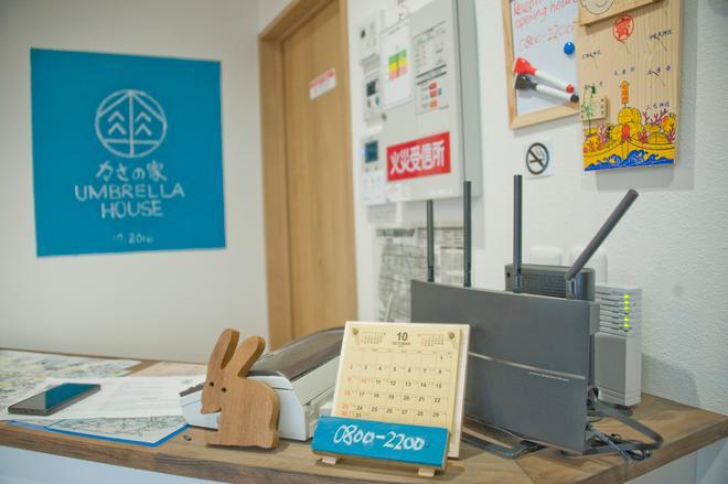 Umbrella House Osaka - Hostel - Osaka - Front desk