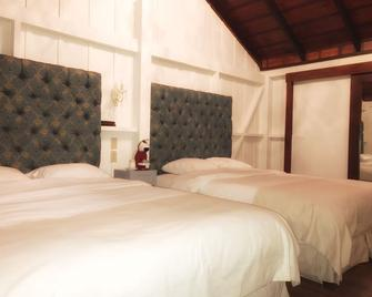 Finca Lerida Coffee Plantation & Boutique Hotel - Boquete - Slaapkamer
