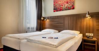 Novum Hotel Leonet Köln Altstadt - Colonia - Camera da letto