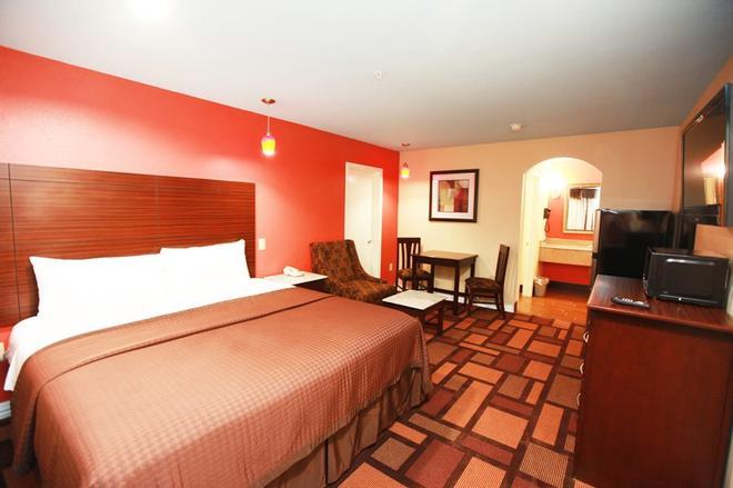 Home Place Inn - Houston - Habitación