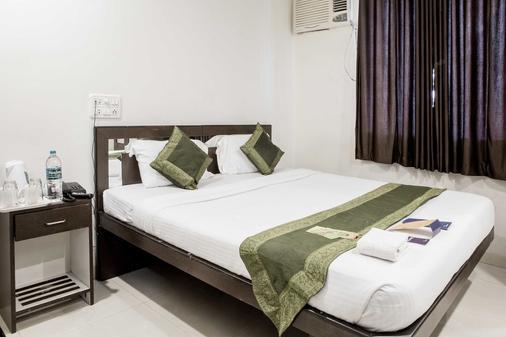 Fabhotel Midaas Comfort - Мумбаи - Спальня
