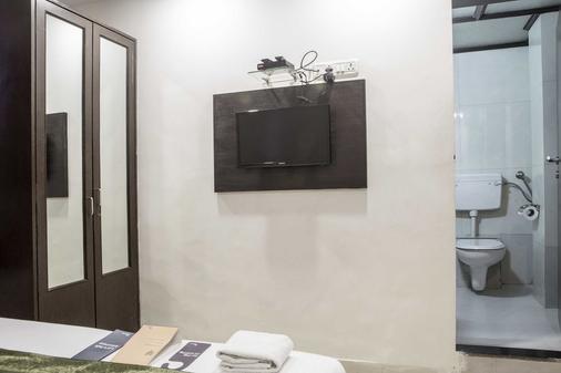 Fabhotel Midaas Comfort - Мумбаи - Удобства в номере
