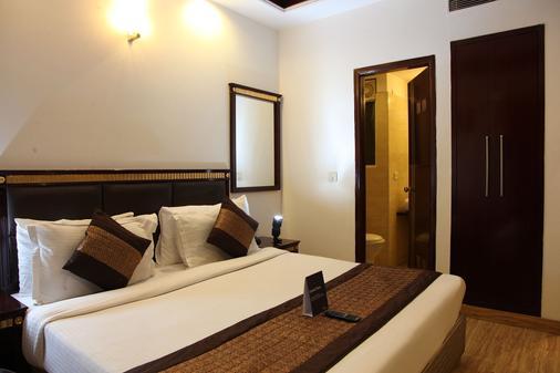 Fabhotel First Star Golf Course Golf - Gurgaon - Schlafzimmer