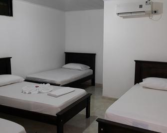 Aparta Hotel El Cacique Upar - Валедупар - Bedroom