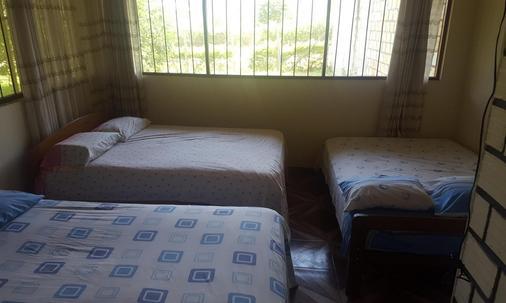 塔拉波托秘呂華美達旅館 - Tarapoto - 臥室