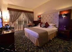 Dar Al Taqwa Hotel - Medina - Phòng ngủ