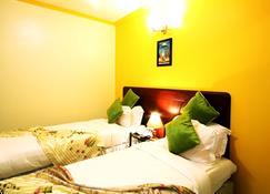 Crest Safari Lodge - Arusha - Schlafzimmer