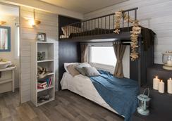 Camping Le Capanne - Bibbona - Bedroom