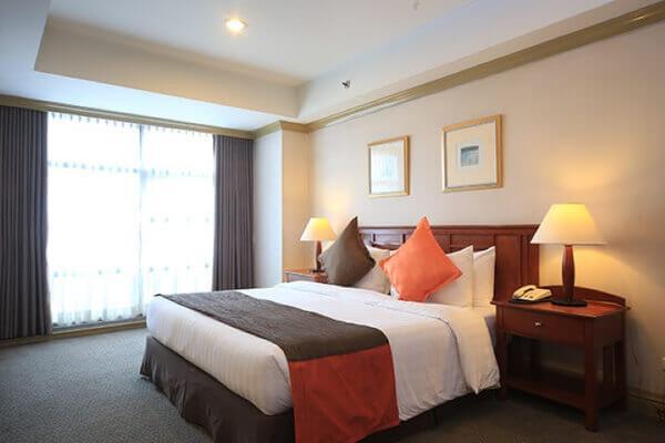 無限塔樓套房酒店 - 馬卡蒂 - 臥室