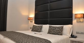 Hotel Selu - קורדובה - חדר שינה