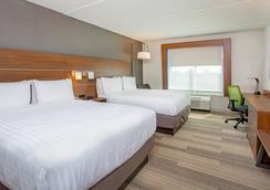 Holiday Inn Express & Suites Covington - Covington - Schlafzimmer