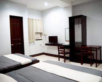 Rehan Grand Suites - Dipolog - Schlafzimmer