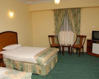 Hotel Crown Inn - Карачи - Спальня