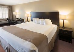 Moberly Inn & Suites - Moberly - Schlafzimmer