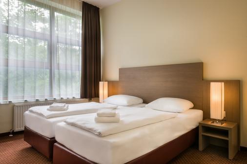 Novum Hotel City B Berlin Centrum - Berliini - Makuuhuone