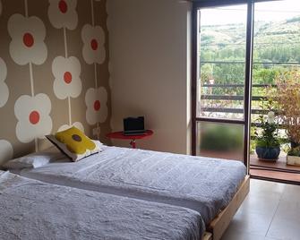 Hostal El Crucero - La Magdalena - Bedroom