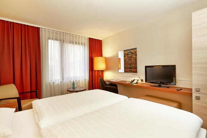 H+ Hotel Hannover - Ганновер - Спальня