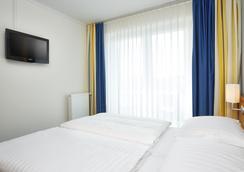 H+ Stade - Stade - Bedroom