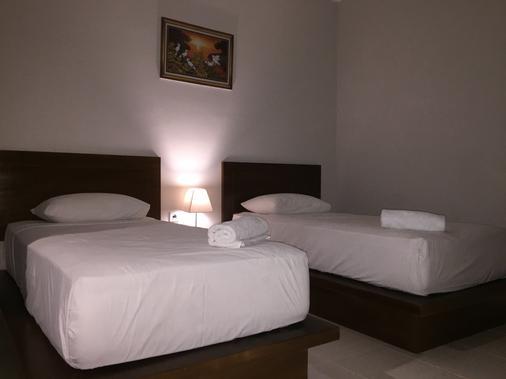 3d Home Stay - South Kuta - Phòng ngủ