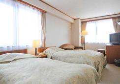 Niseko Park Hotel - Niseko - Bedroom