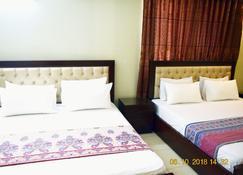 Prime Dha Guest House - Karatschi - Schlafzimmer