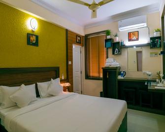 Blue Bell Airport Hotel - Nedumbassery - Schlafzimmer
