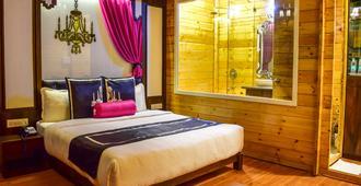 Estrela Do Mar Beach Resort - A Beach Property, Goa - קלנגוטה - חדר שינה
