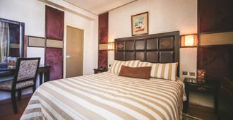 Hotel Bab Mansour - Meknes - Phòng ngủ
