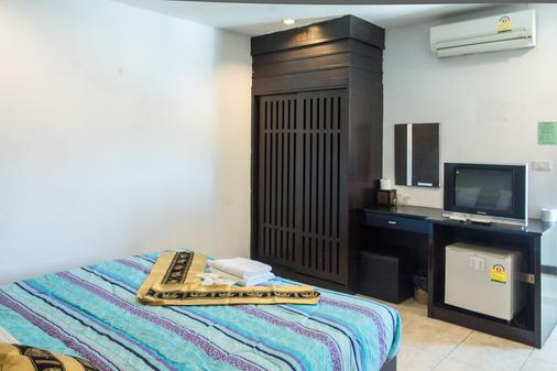 Patong Bay Guesthouse - Patong - Makuuhuone