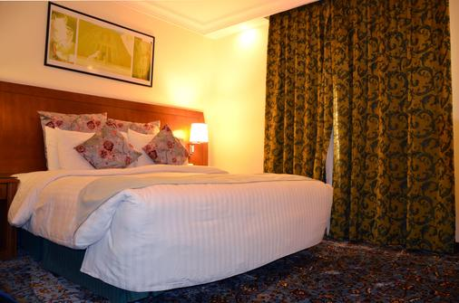Amra Palace International Hotel - Wadi Musa - Schlafzimmer